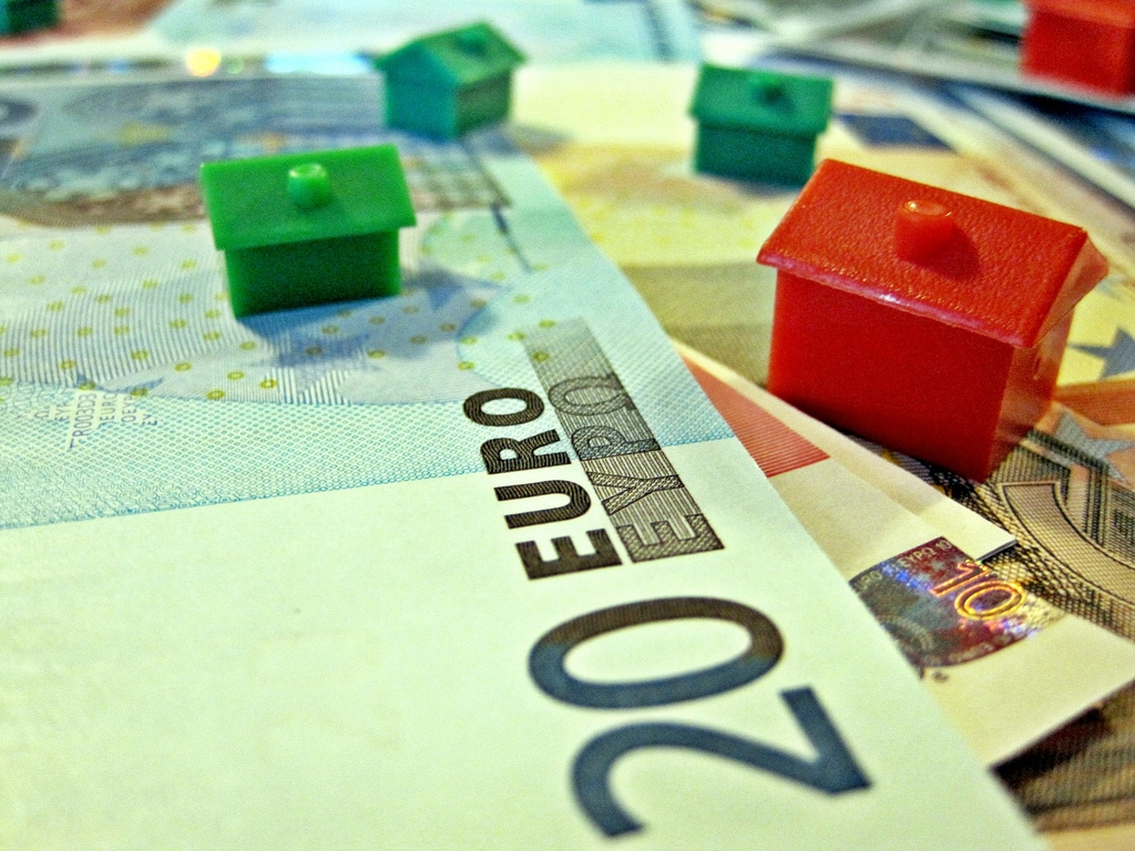 Euro currency and houses.